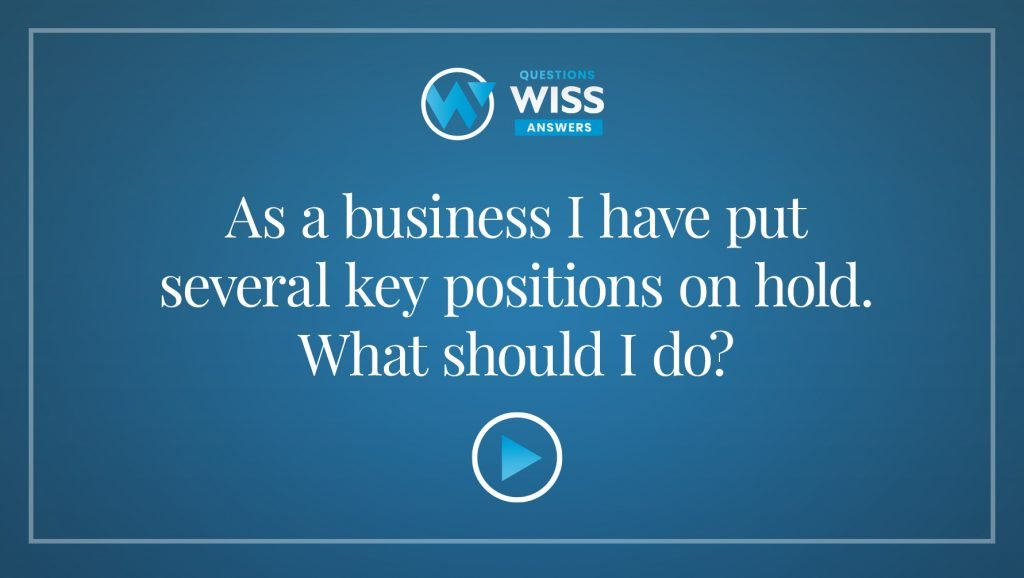 As a business I have put several key positions on hold. What should I do?